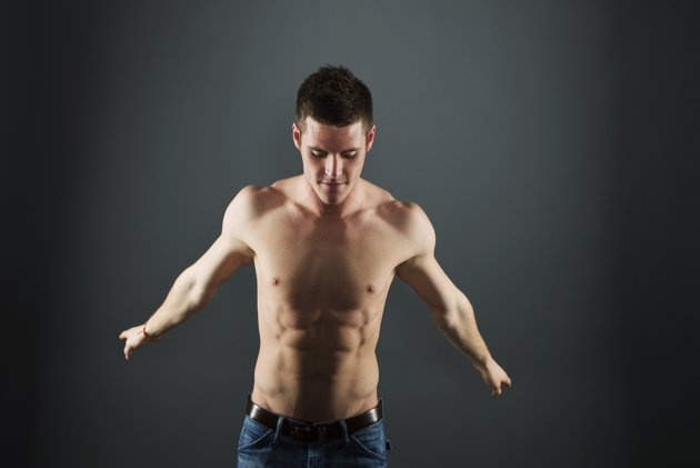 Diver David Boudia stretches while posing for a portrait during the 2012 U.S. Olympic Team Media Summit in Dallas, Texas