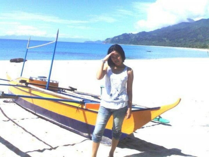 Dinadiawan Beach. My previous employer own a part of this virgin paradise. Water is crystal clear, the sand is so fine, and serene. In this photo, I am about to ride the boat to go to another Island with my colleagues. I was 25 years young at that time and very petit  :)