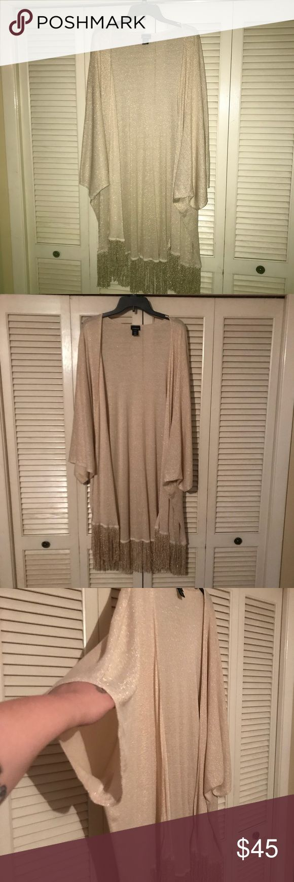 Elegant Torrid Kimono Cardigan 4/5 4x 5x One of my favorite Torrid pieces. Circa 2014 and it's rare to see it on sale. Perfect for the holidays with its slight sparkle and classy champagne color. The fringe at bottom also has shine. It's in new condition. Wore twice. Kimono sleeves hit well past elbow. I wore over a torrid maxi with big hoop earrings and booties. 37 inches long without fringe and 43 inches with. torrid Tops