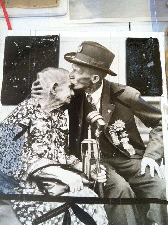 Alice Carey Risley the last surviving Civil War battlefield nurse receiving a kiss from a veteran. (From the collection of the Union Veterans of the Civil War)