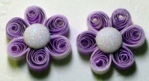 "Purple Stud Earrings - Purple quilling stud earrings with bling make a fashion statement.  The color is light purple almost lavender; a good color to blend with purple or pink hues.  The bling reflects colors and is shines bright.  Some like big earrings that shout for attention and others like the smaller earrings.  These are ¾"" wide just perfect size for some people.  To read rest go to www.artbybetty.blogspot.com"