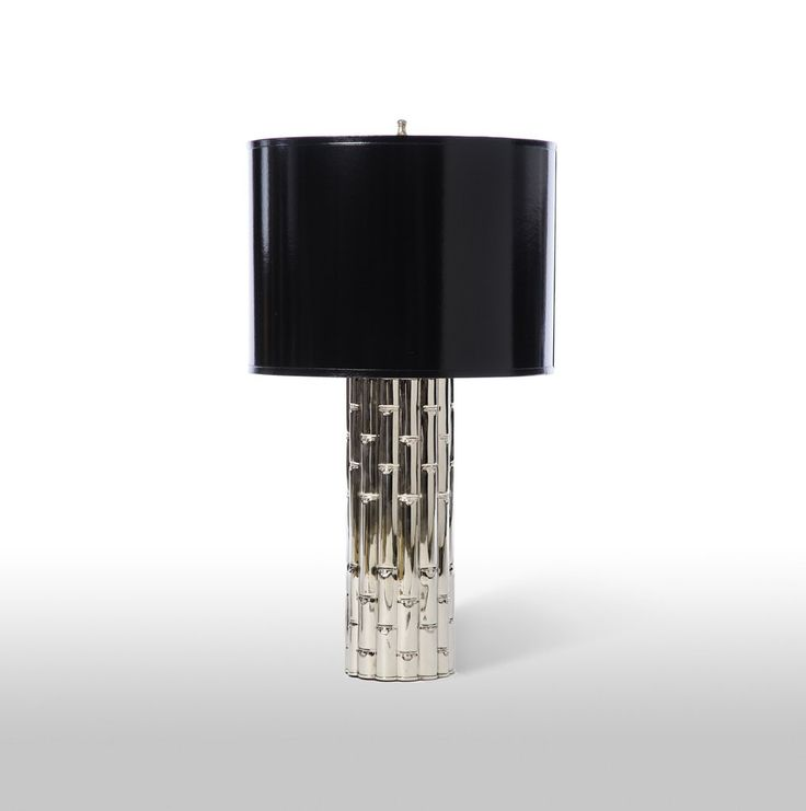 The Barbara Cosgrove Lamps Bamboo Table Lamp features a shiny nickel finished column design topped with a black gloss finish on painted parchment drum shade. Un