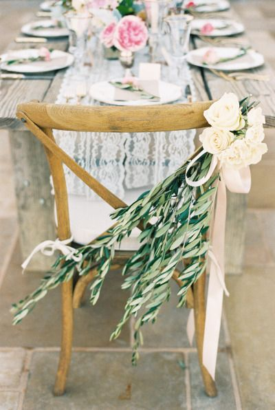 Olive branch stems, roses and soft pink ribbon: http://www.stylemepretty.com/little-black-book-blog/2014/10/31/intimate-sunstone-villa-wedding/ | Photography: Khanh Hogland - http://khanhhogland.com/