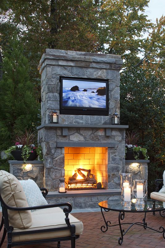 Fabulous outdoor fireplace with tv!