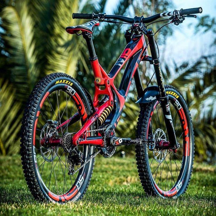 Gorgeous Downhill Mountain Bike. Red mountain bike. biking across the world.