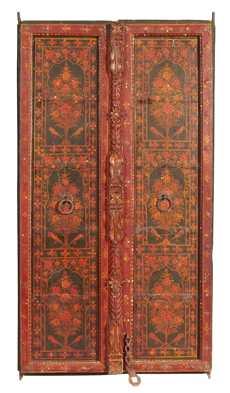 This beautifully painted in red, black, and yellow, green, orange and white colored small door probably belonged to the interior of a Rajasthan haveli.