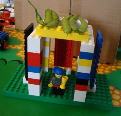 Sukkah made out of Legos! I love the pea pod roof. :)