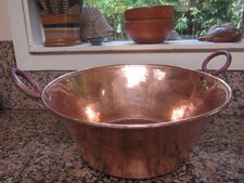 A traditional Copper Cazo, handmade by artisans in Santa Clara del Cobre, Michoacán. It can be used for cooking different foods, but especially good for making cajeta (dulce de leche) and jam. The big ones are for making carnitas! Small ones are great for putting your cerveza on ice. Available in various sizes and by special order.