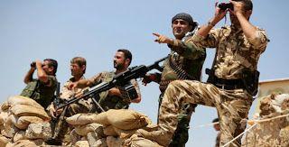 Οι συριακές κουρδικές δυνάμεις που μάχονται κατά του Ισλαμικού Κράτους στη βόρεια Συρία βρίσκονται πολύ κοντά στο να περικυκλώσουν μια μεγάλη περιοχή βόρεια του προπυργίου