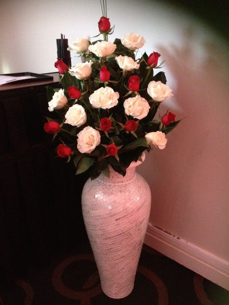 Long Stem Red and White Roses in a Tall Vase