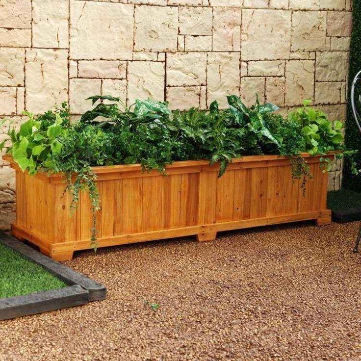 bac-fleurs-bois-DIY-grande-taille-plantes-vertes-clôture-pierre-jardin bac à fleurs en bois