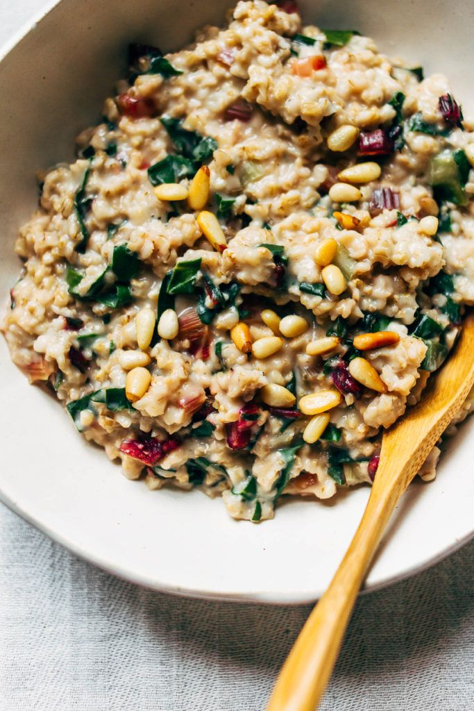 creamy steel cut oats with rainbow chard + pinenuts