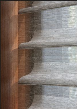 Hunter Douglas Silhouettes (the most expensive semi-sheer blind you can put on a window, but also the most beautiful!