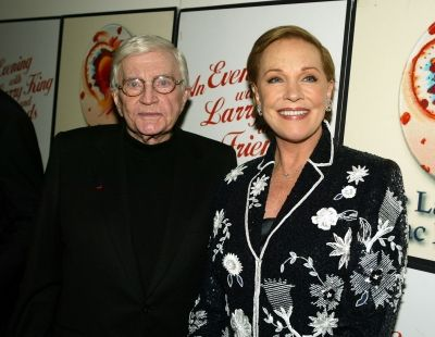 Director Blake Edwards (L) and his wife Julie Andrews arrive at An Evening With Larry King and Friends benefiting The Larry King Cardiac Fou...
