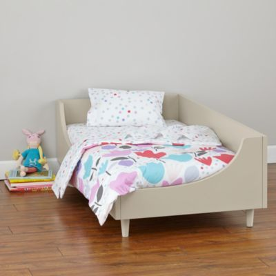 The clean and timeless design of our Hampshire Toddler Bed means it'll work well regardless of your style or décor.  Available in Stone or Clay, it features an easy-to-coordinate neutral finish that'll work in a boy's room or a girl's room.  Plus, its solid mahogany construction makes it as durable as it is beautiful. Safety first Meets or exceeds all U. S.  government safety, ASTM and CPSC standards The minimum age should be no less than 15 mos.