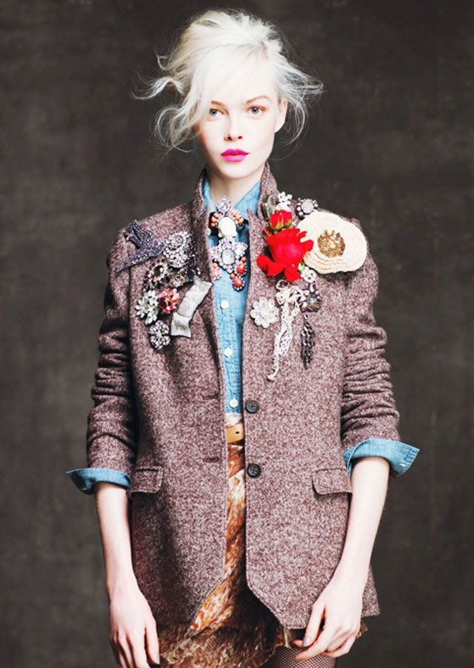 vintage brooches add drama to a tweed jacket...that is just a little too much Drama...i'm just sayin'