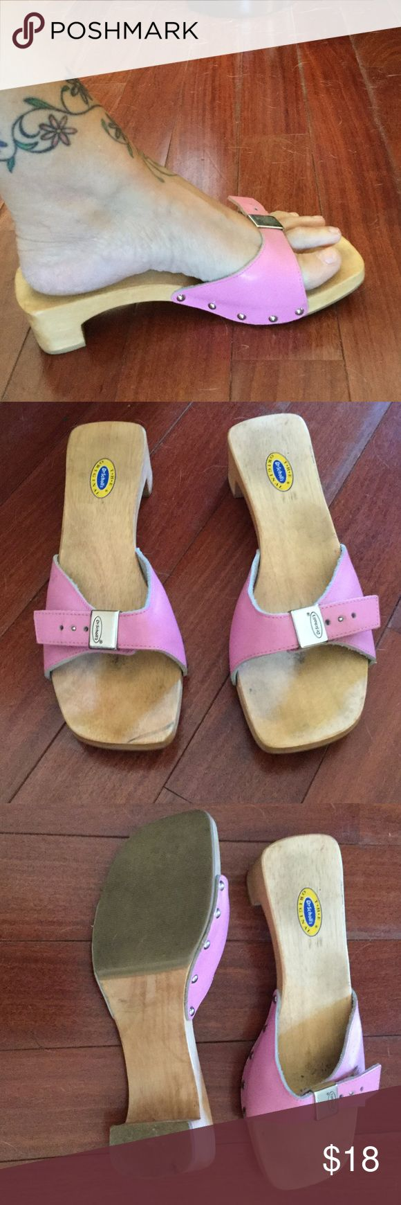 Pink Dr. Scholl's sandals Pink Leather sandals with 1.5inch wooden heel. There is wear to the shoe as you can see in the pictures. The pink leather and buckle are in great condition....little scuff on the pink.....as shown ......just wear to the sole of the shoe 👠 dr scholls Shoes Sandals