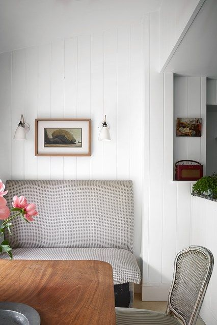 Ideas for small dining rooms - from furniture - tables, seating and suites to cabinets and dressers to paint and decoration - on HOUSE including this panelled white room with banquette seating.