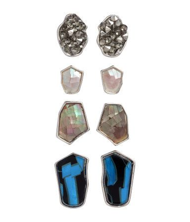Metal stud earrings with shimmery plastic beads. Diameter from 1/2 in. to 3/4 in.