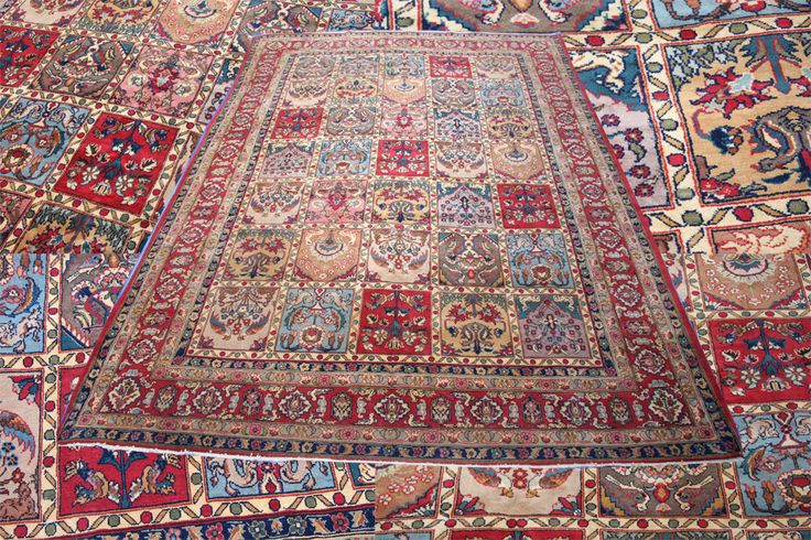 This fine Indian handmade room size carpet brings about the characteristics and design seen in Persian rugs, it has rows of garden or panel design decorated with floral motifs and objects in pastel colours. The detailed motifs have spread into the colourful borders and given the carpet a powerful present.