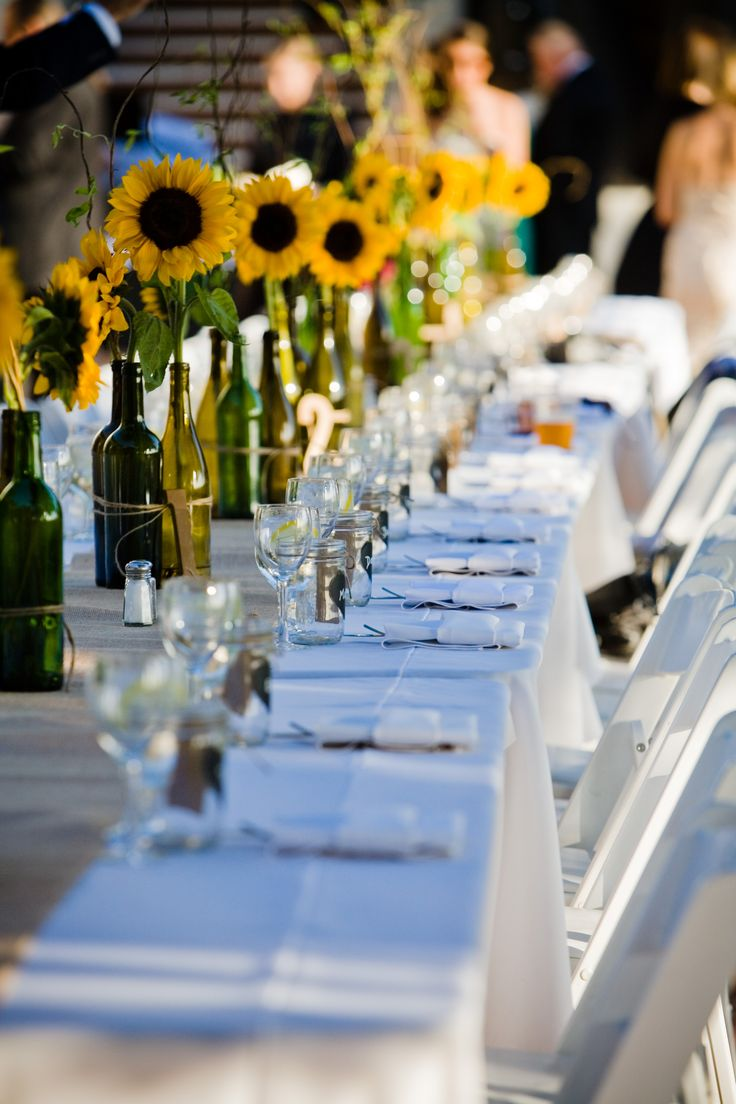 Sunflower and wine bottle centerpieces tied with twine on burlap runner #sunflowers #rusticwedding https://www.etsy.com/listing/160575633/rustic-wedding-wooden-table-number-set-1 #etsy
