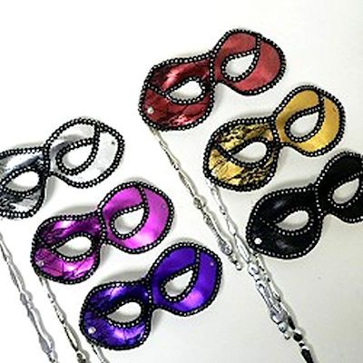 Popular for proms, these masks in a stick have a variety of color choices and fold up for a convenient way to carry when not in use.  https://awnol.com/Masks/Masquerade-Masks