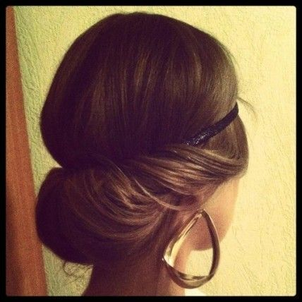 3. Comb out hair, and slip on your headband (it should fall halfway between your hairline and your brows).     4. Band together the ends of your hair with a clear elastic, then give the tail a twist and tuck it up, over, and into the headband. Tuck in as little or as much as you like!     5. Finish with a mist of strong hold hair spray   @Martha Stewart Weddings Magazine
