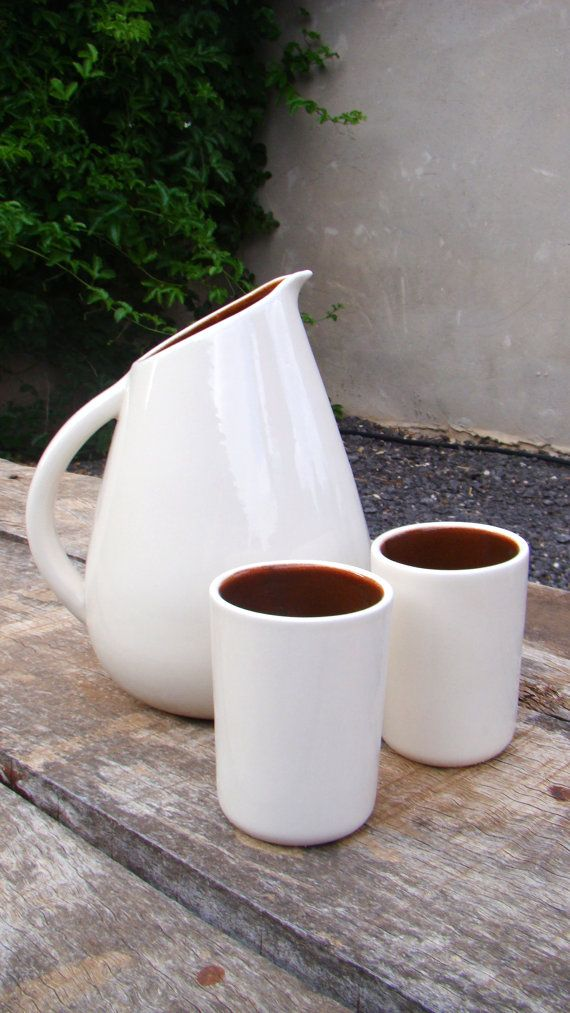 Pitcher with hand-carved rim for a fun angle? Interesting.