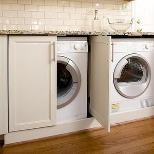 Twin Companies - laundry/mud rooms - hidden laundry room, hidden washer and dryer, shaker cabinets, laundry room, laundry room cabinets, granite counters, granite countertops, subway tiles, subway tile backsplash,
