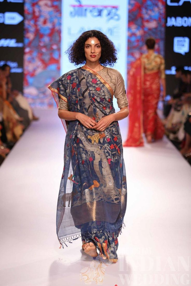 """Gaurang Shah's collection, """"Kalpavriksha"""" brought out the best of traditional Indian weaving at Lakmé Fashion Week Summer/Resort 2015.  Kalpavriksha is the wish-fulfilling divine tree in Hindu mythology. Revisiting the humble khadi (the fabric of freedom) with a representation of the Tree of Life, the Jamdani weavers of Andhra Pradesh and  [...]"""