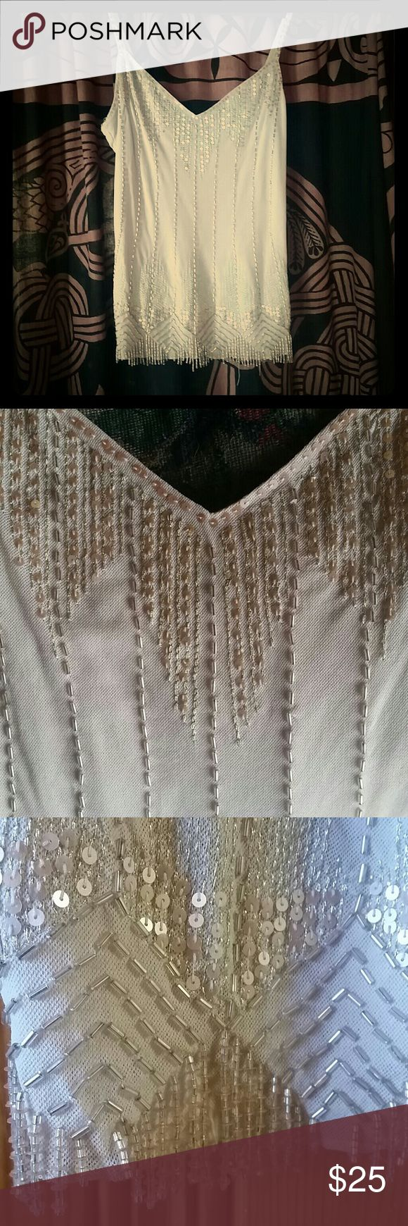 Dressy Beaded Cami Beaded beige cami with hanging beads at bottom, sheer nylon, hand wash. Express Tops Tank Tops