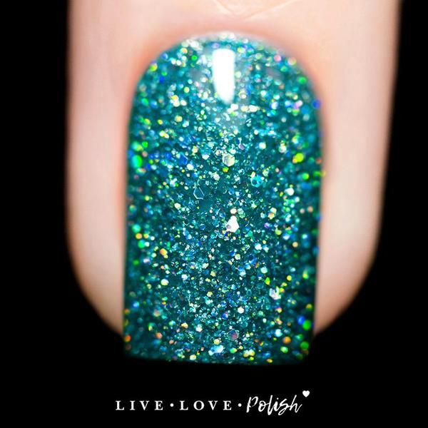 turquoise jelly nail polish with silver holographic glitter