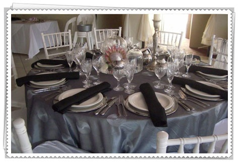 Also think this silver table cloth is amazing... would tie in with the pink roses!  Would need x 12???