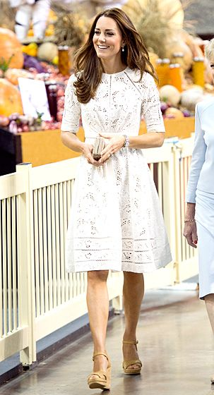 The Duchess looked radiant in a white eyelet dress by Zimmermann while visiting the Royal Easter Show on April 18, 2014. She paired the fit-and-fl...
