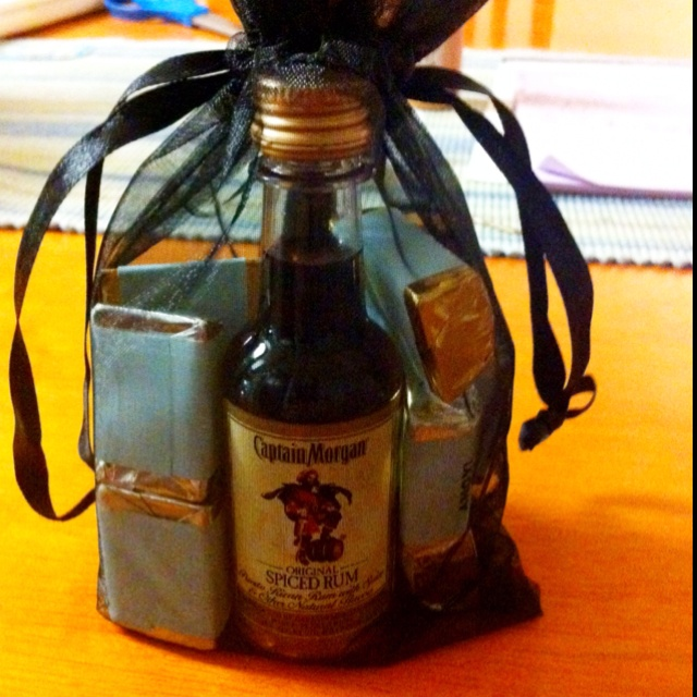 "Pirate baby shower ""Loot Bag"": Hershey Nuggets, a bottle of Rum and a bottle of OPI nail polish from their ""French Touring"" line (since Mommy is from France)."