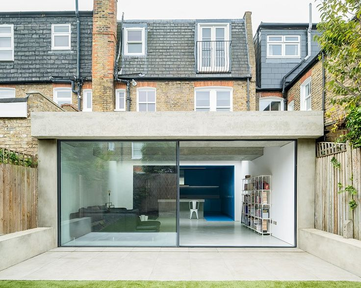 the distinctive roof over the new living area gives the immediate effect of a simple concrete slab which contrasts with the texture of the original building.
