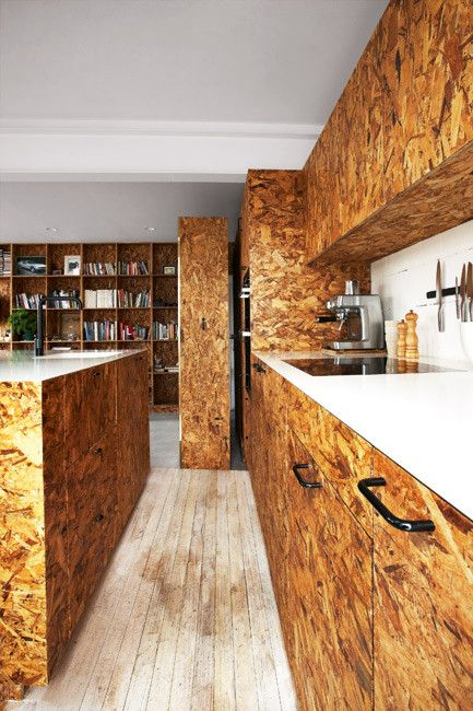 OSB sheeting is used throughout the kitchen.
