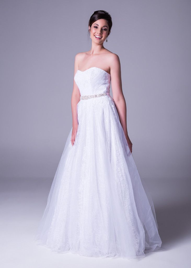 Something so simple can look breathtaking. Get this #tulle #wedding #dress with empire waist and #lace bodice - only at Bride&co South Africa stores. Style >> WPD17823. #brideandco