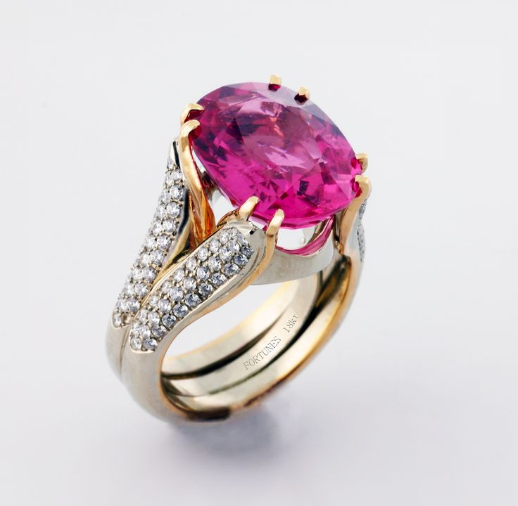 Vivid pink tourmaline accented by two-tone gold and diamonds.
