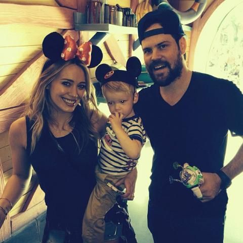 HILARY DUFF AND MIKE COMRIE - Hilary wearing Minnie Mouse ears with her son sporting a classic Mickey Mouse Club hat.