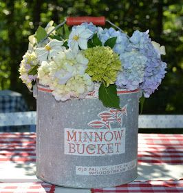 Minnow/bait bucket used to hold variety of flowers is perfect for fun, casual outdoor party!
