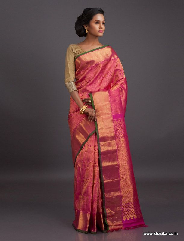 A display of the grandeur of Gadwal weave, this pink silk saree immersed in intricate golden zari surely makes for great wedding attire. Gadwal sarees are renowned for admirable zari patterns and well-crafted pure silk kuttu borders and pallus. Exhibiting a remarkable trait of getting folded down to the size of a matchbox, our Gadwal Silk Sarees online have demand throughout the country.