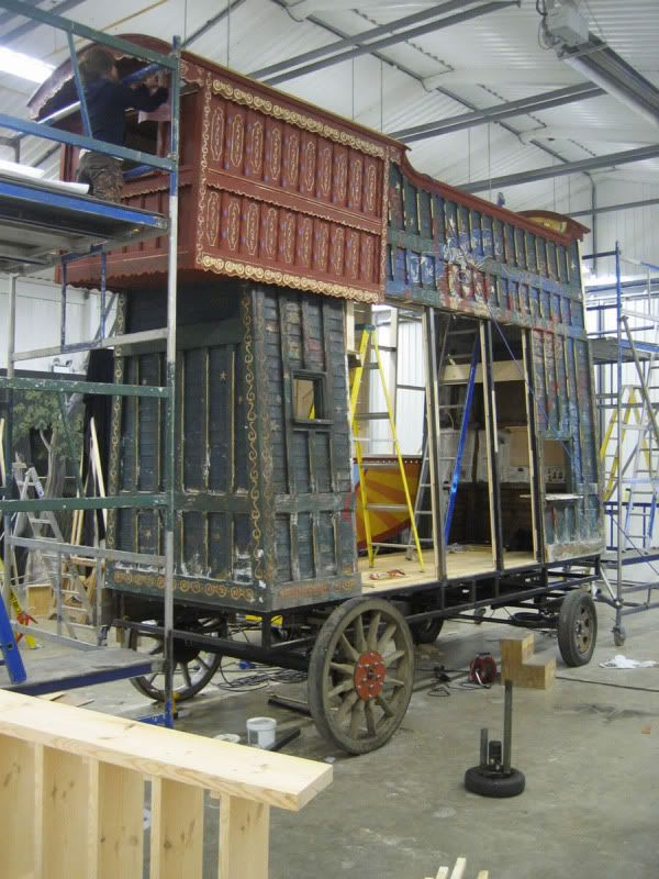 the making of parnassus wagon box section clad with light weight wood then decorated.