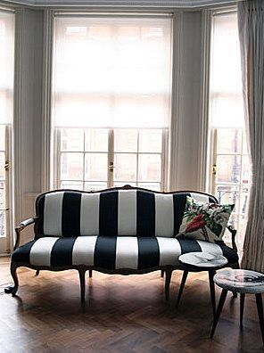 large black and white striped sofa