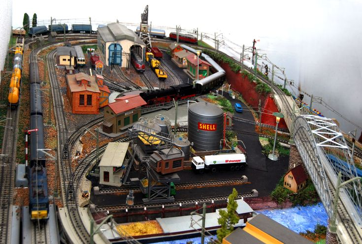 Marklin train layout with port and industry scenery.