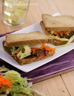 Another treat for the indian taste buds, the potato tikki sandwich is made with a flavourful cutlet of potatoes spiced with amchur, nigella seeds and other spices. This sandwich makes use of a combination of white and brown breads, which adds to its taste.