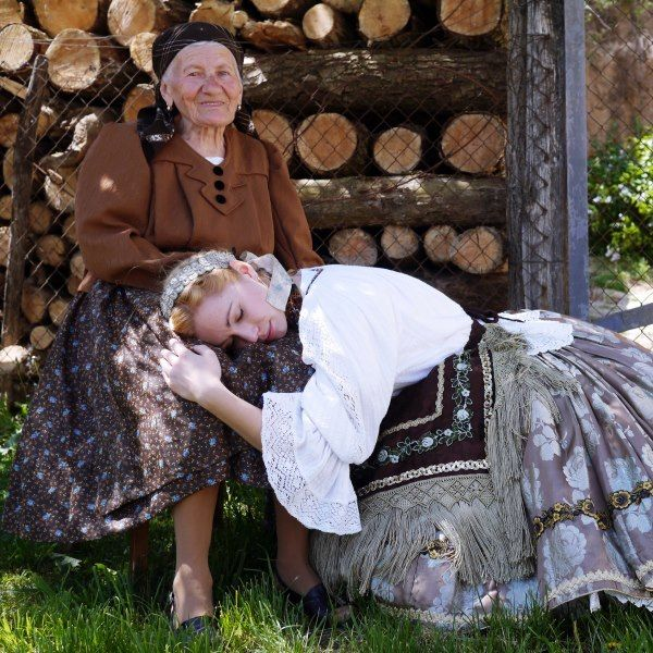 hungarian generations in folk wear.  The neni's face has so much history and happiness written on it.