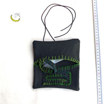 Denim fabric tabacco pouch hand-stitched.  Housing for cigarette papers and filter sachet. Natural rubber lace. Color: Dark and light green. I used fabrics from clothes disused and cotton cord handmade colored.  This tabacco pouch will help you to clear up your bag and have everything you need always at your fingertips. Follow me on fb: https://www.facebook.com/MaliceCrafts/