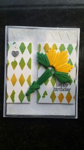 Using a quilling comb, stencils and embossing paste....