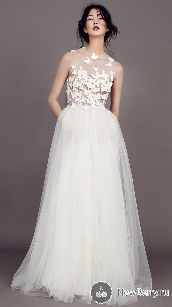We are head over heels in love with this summery wedding dress from Kaviar Gauche 2015 collection
